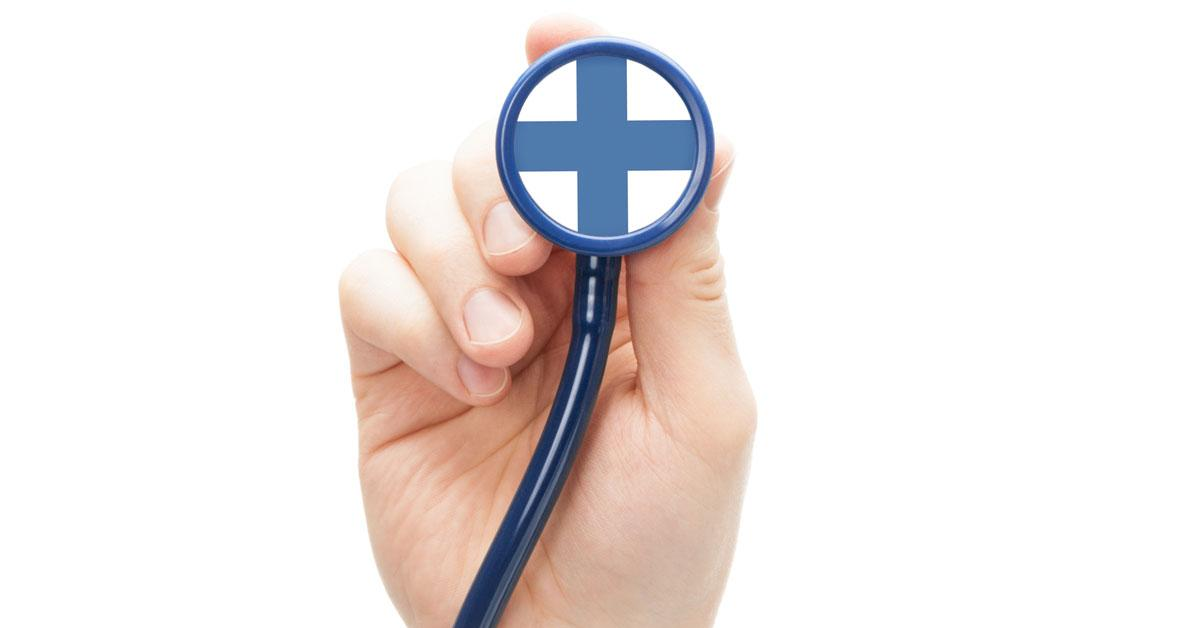 Hand holding stethoscope with Finnish flag on it
